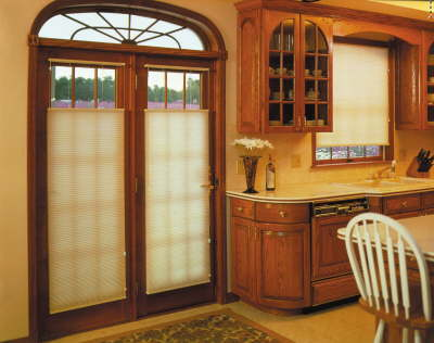 EcoSmart shades are perfect for doors because they have a low profile and are hardly visible when raised.